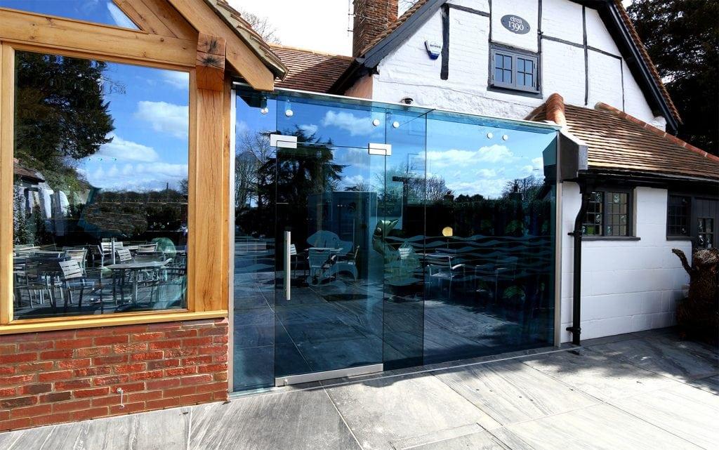 Glass box restaurant entrance atria
