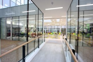 Office walkway with structural glass walls