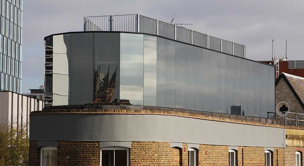 Reflective Glass Cladding
