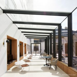 Recreational space retractable glass roof