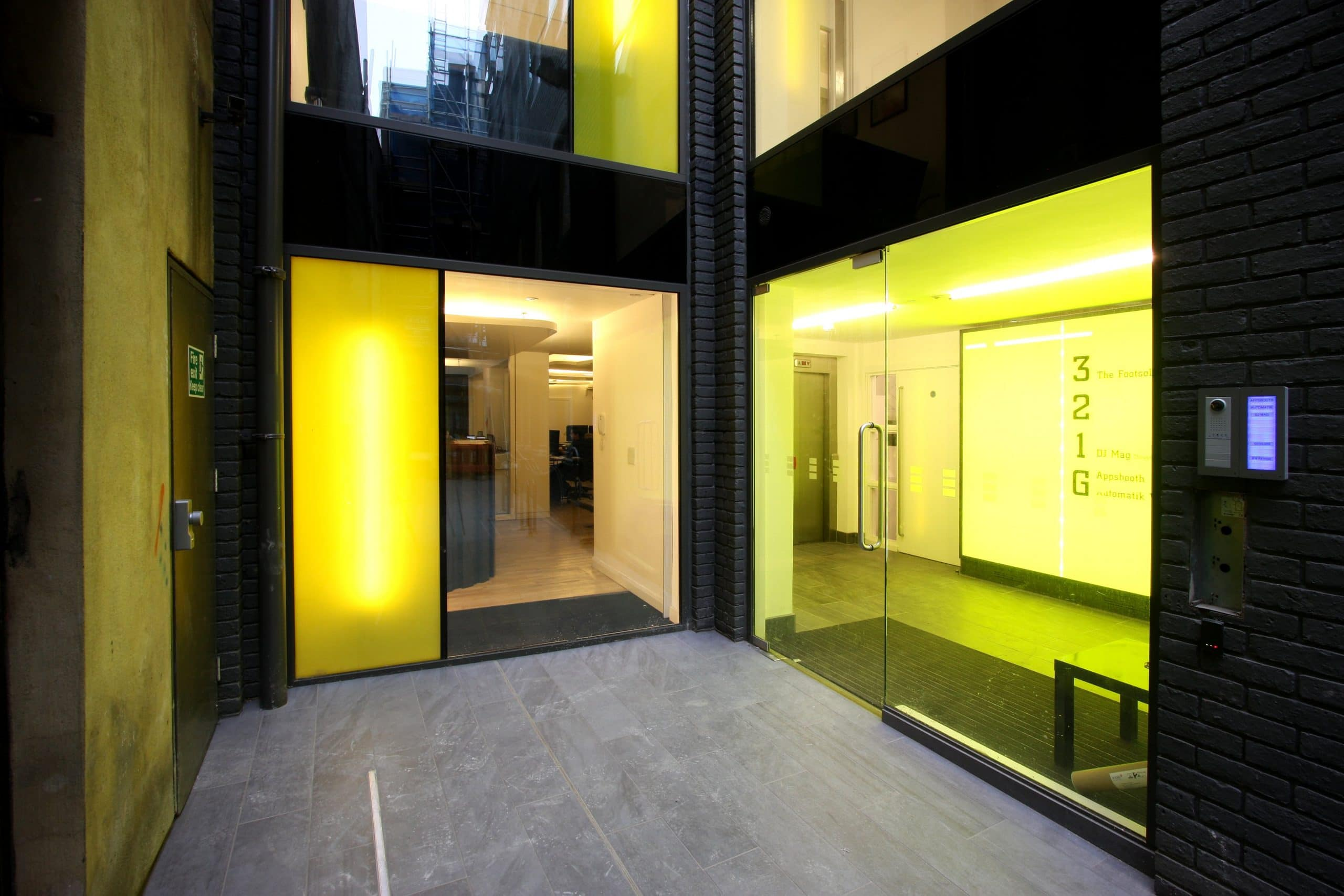 coloured sturctural glass in a mdoern london office design