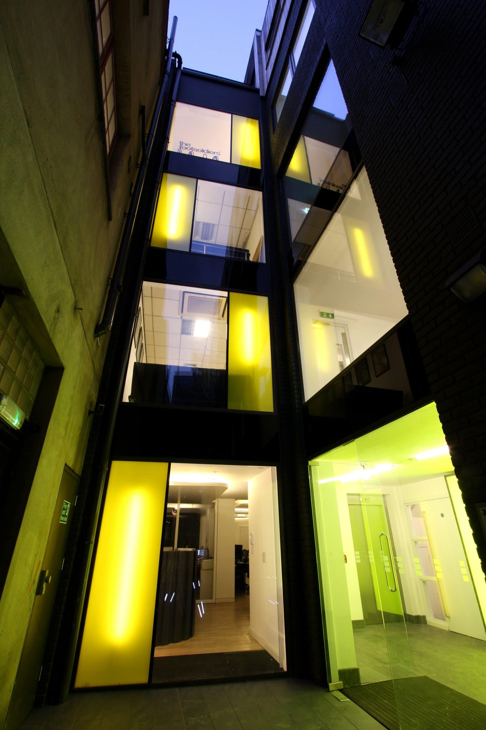decorative structural glazing with a yellow interlayer used in a shoreditch office design