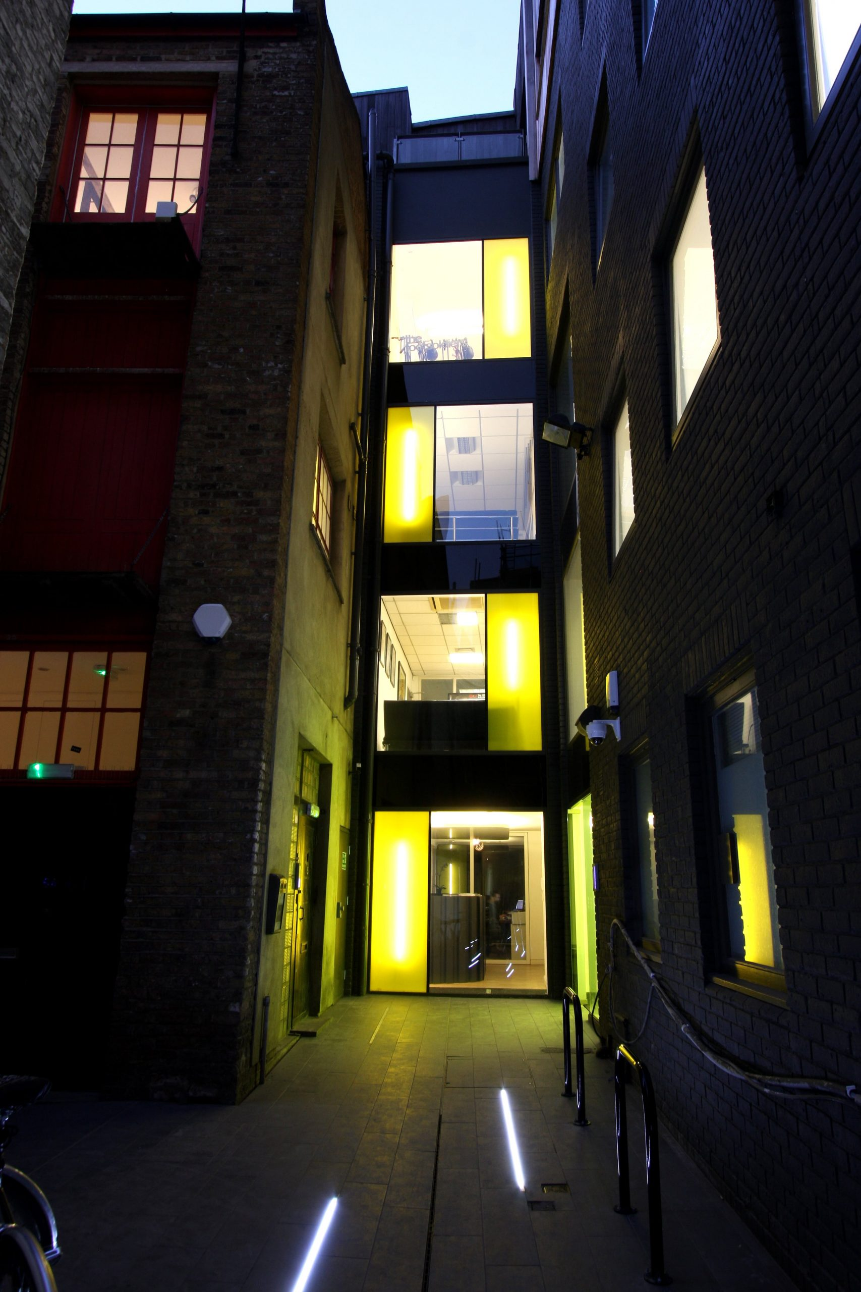 three-storey office builing with yellow decorative structural glazing
