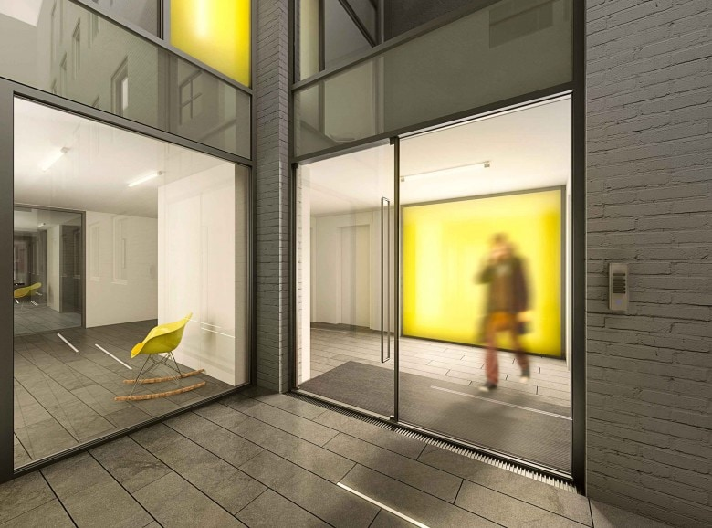 unqiue frameless glass facade with a yellow coloured interlayer