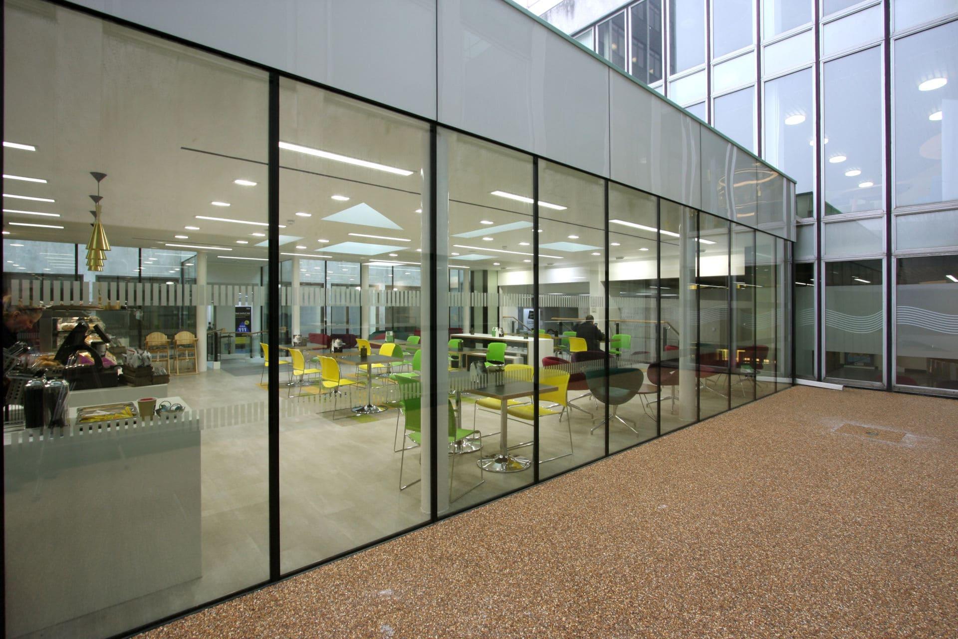 Frameless glass office wall