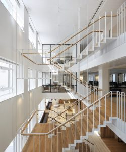 Modern office staircase with glass walls