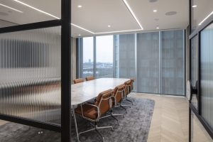 Contemporary office space with fluted glass partition