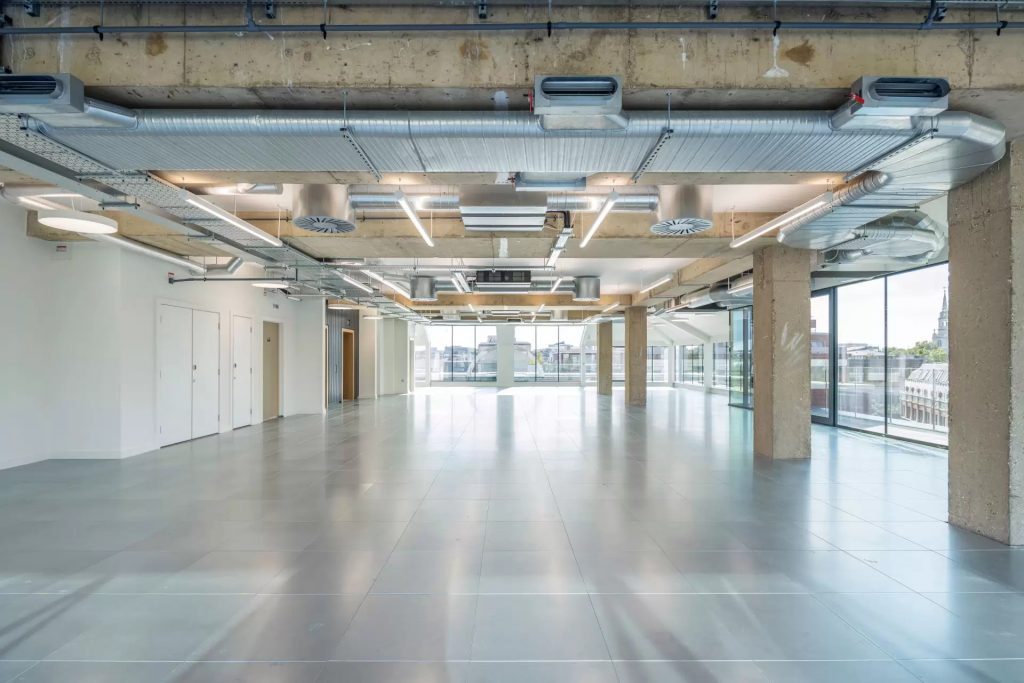 Exposed industrial look office space with glass walls
