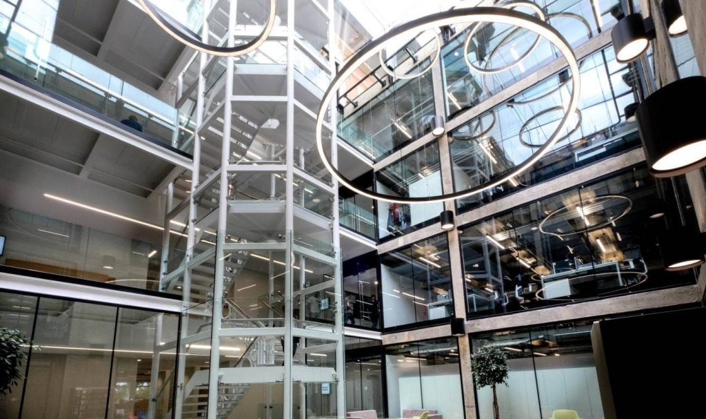 Internal office building with multi-storey glass facades, structural glass walls and fire-rated glass doors