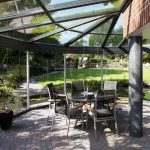 Internal garden courtyard with structural glass walls and roof