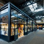 Boutique shop with industrial look steel glazing
