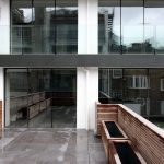 London residential development glass exterior facade with sliding glass doors