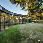 Curved structural glass facade