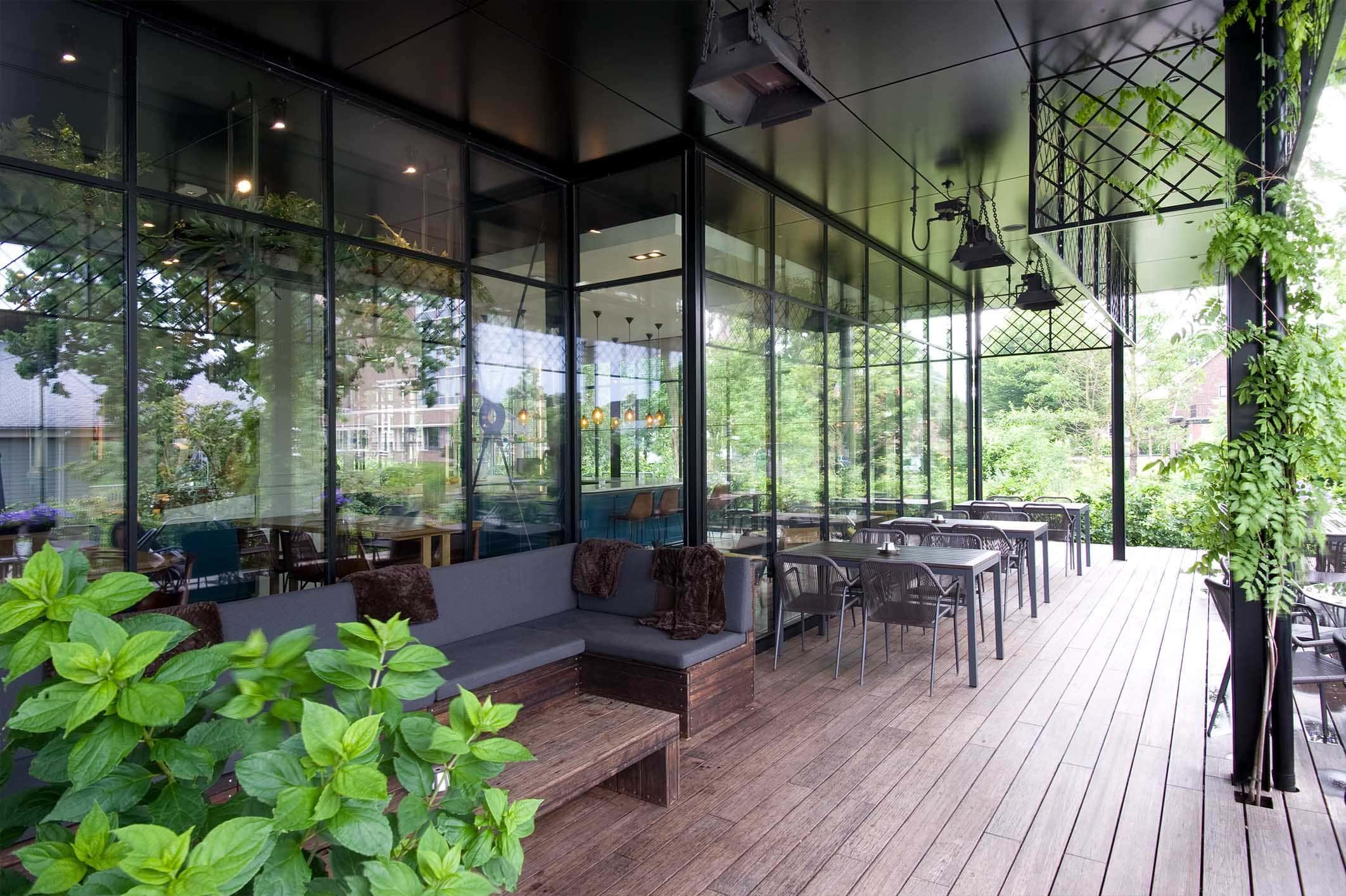 modern restaurant with steel framed glass walls and sliding doors