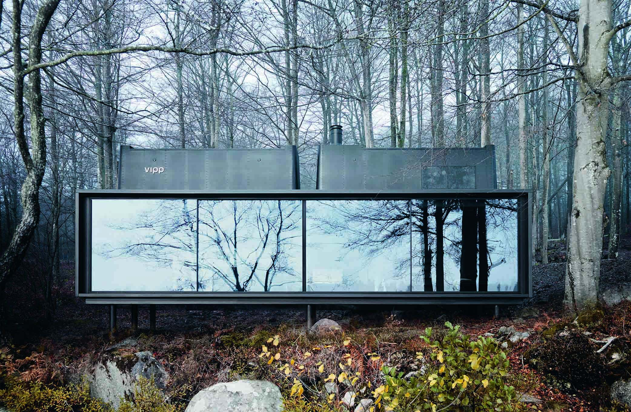 Modern holiday cabin with minimal sliding glass doors