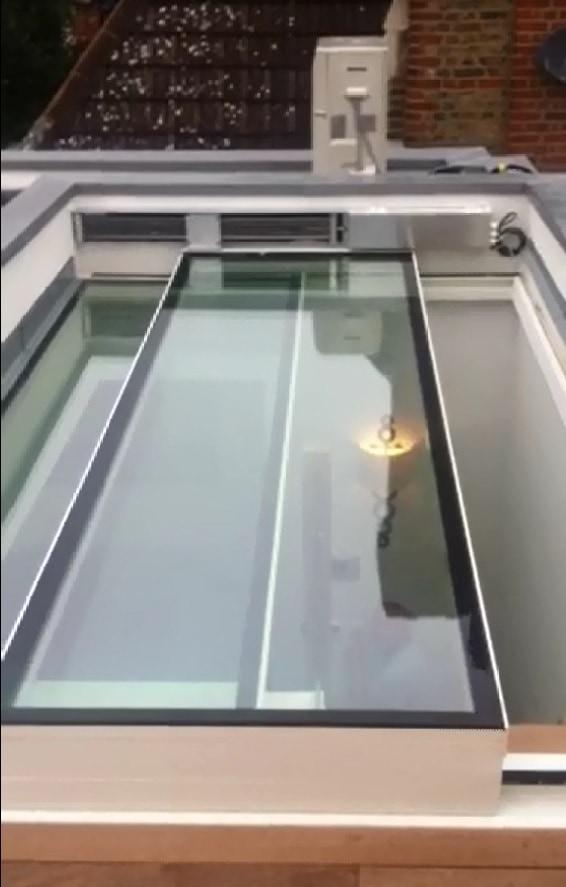 Auto sliding rooflight