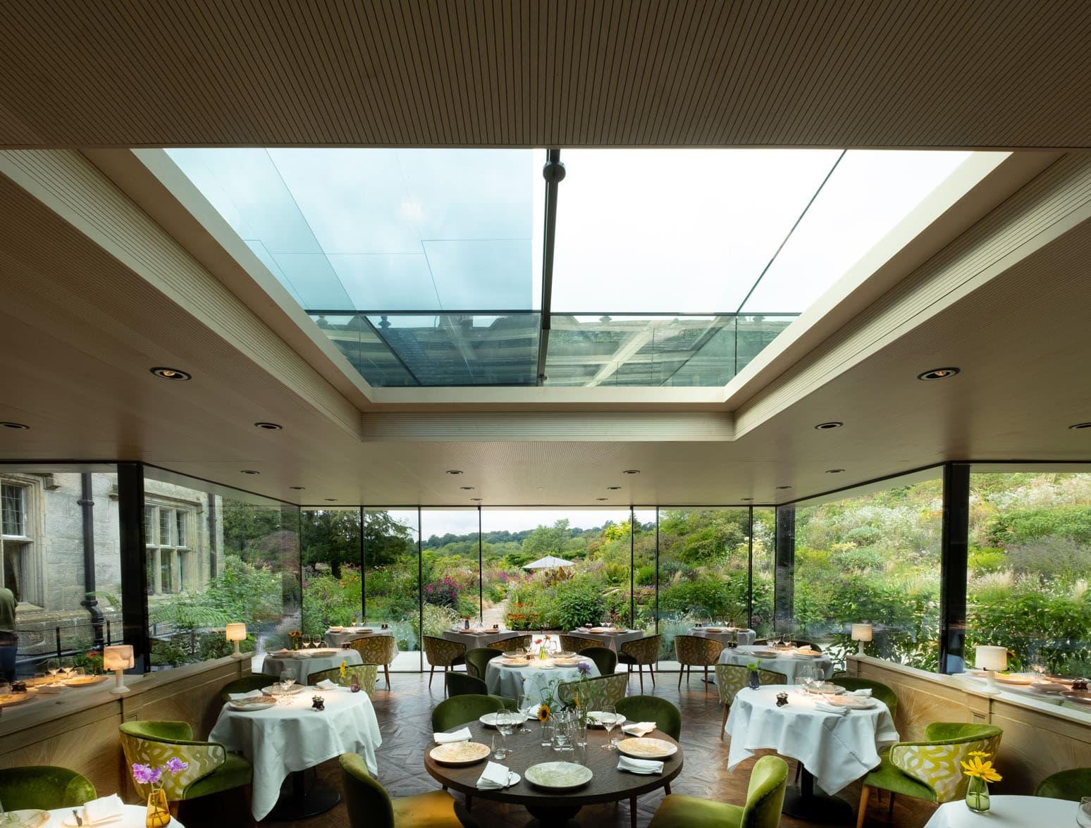 Frameless glass bespoke sliding rooflight