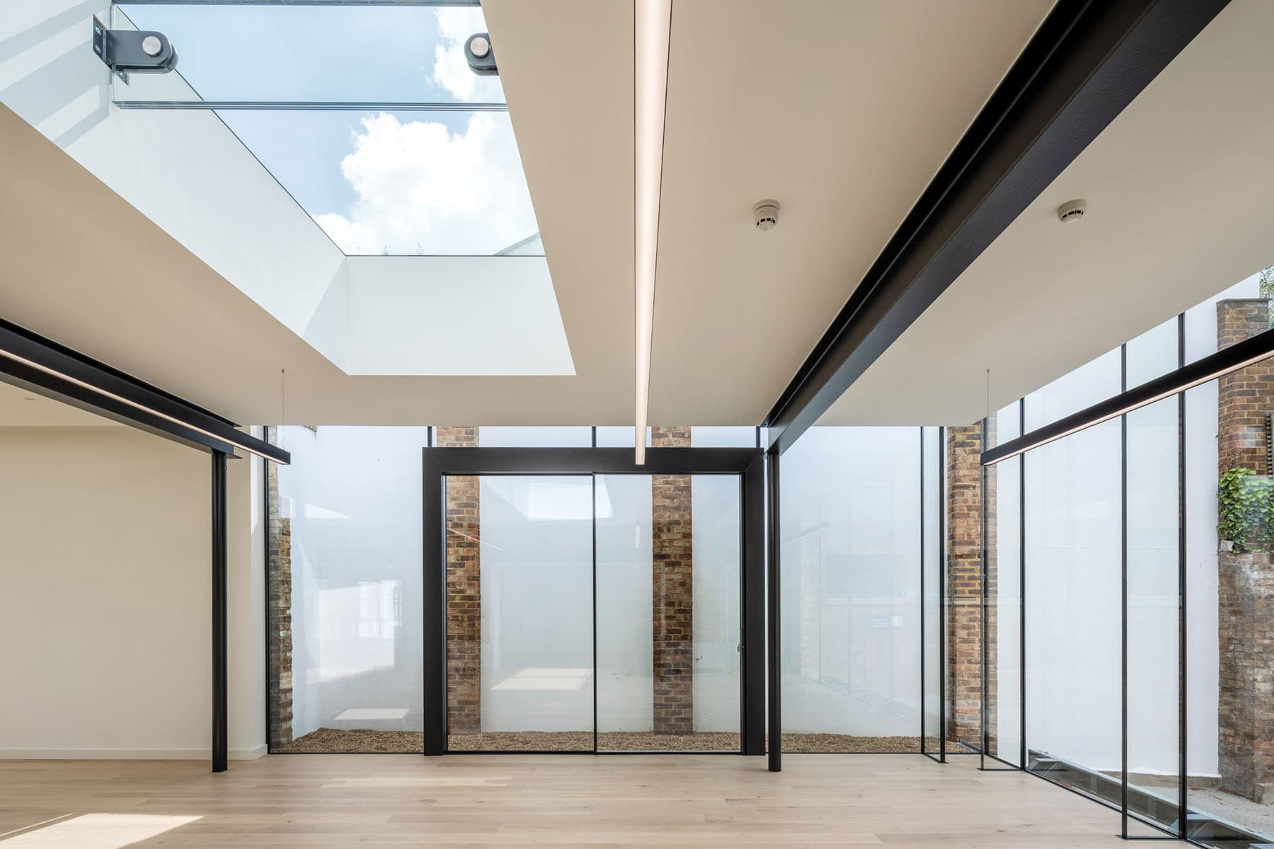 Modern office with frameless rooflights and glass facade