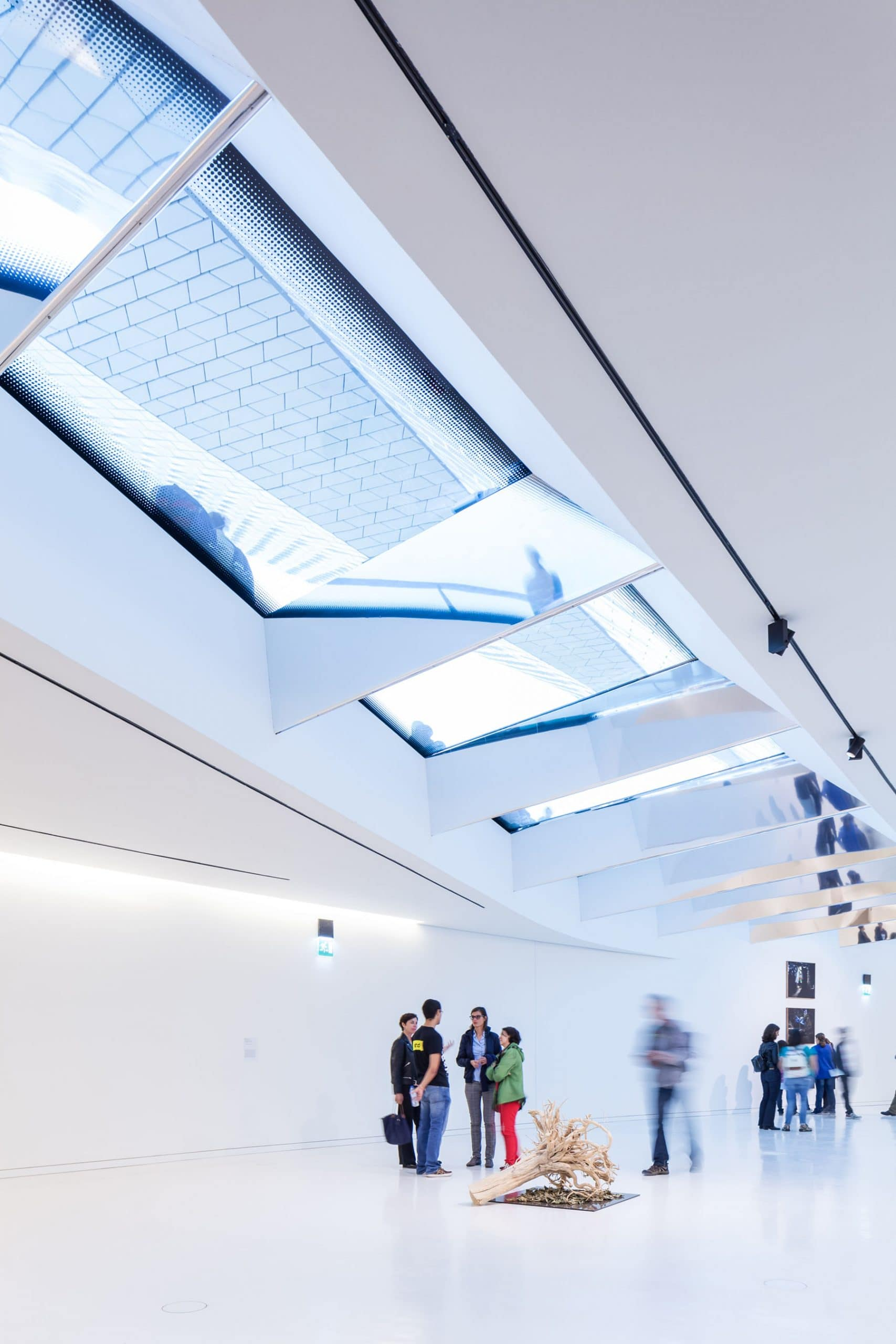 Modern MAAT museum exhibition with structural glass roof