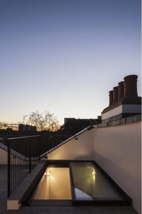 Automated sliding glass rooflight
