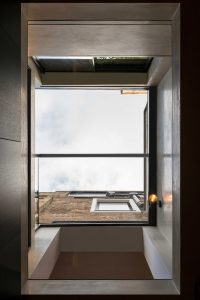 Frameless glass automated rooflight