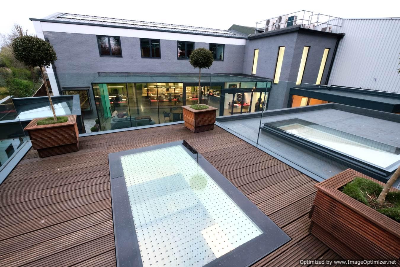 IQ Glass showroom with glass rooflights and structural glass box extension