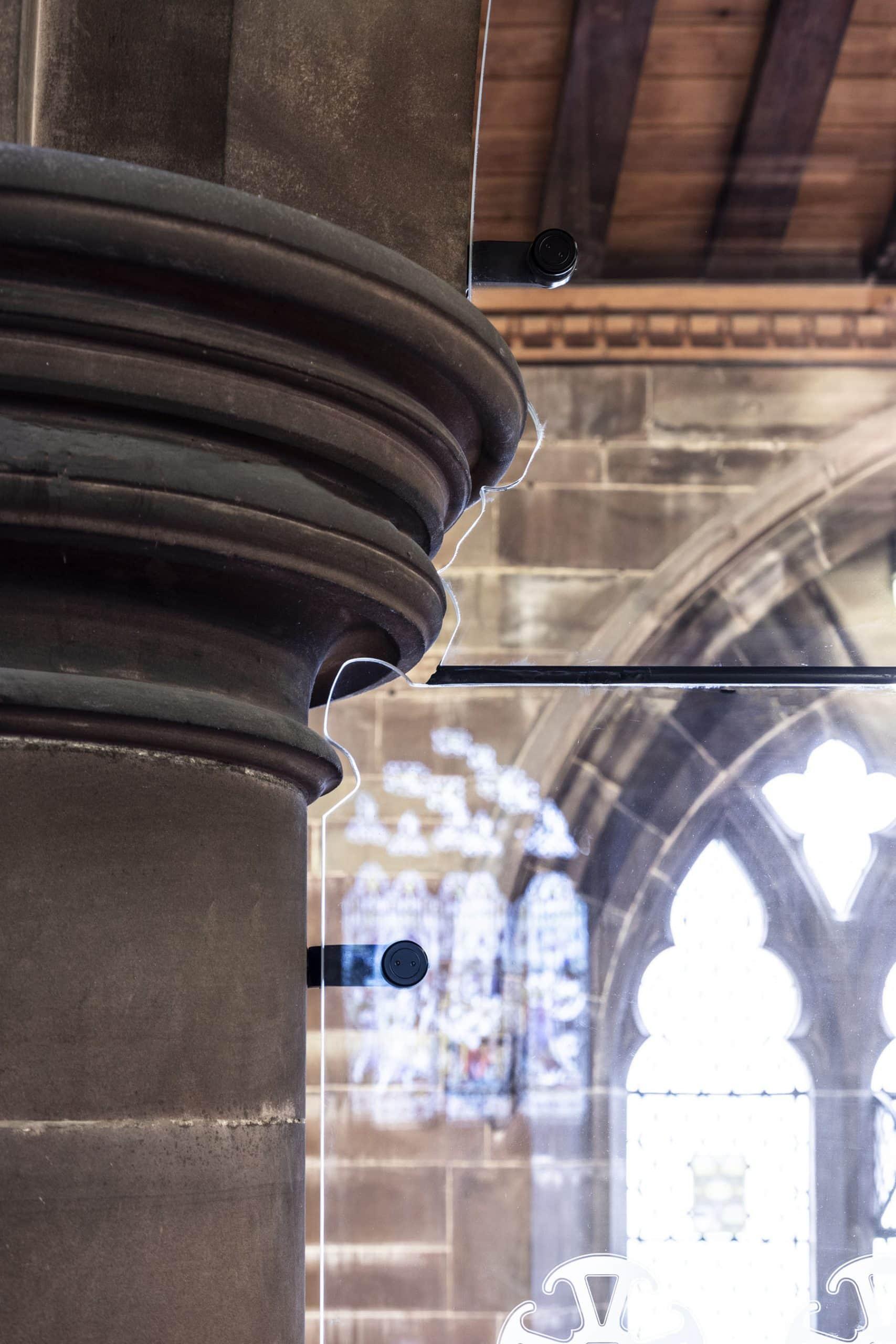 frameless internal glass screen with bespoke cut out fixing to church pillar