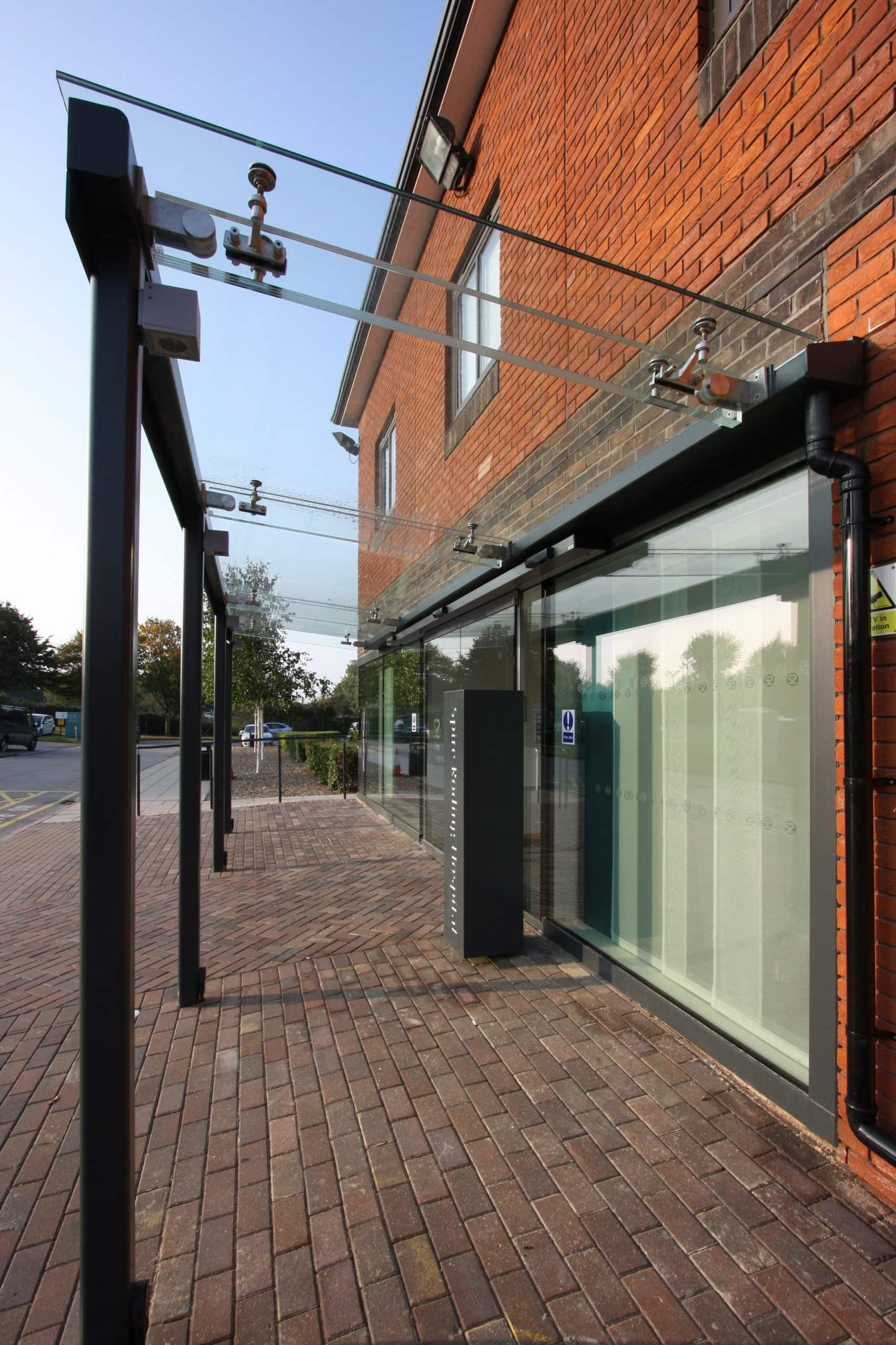 glass canopy used outside an entrance door