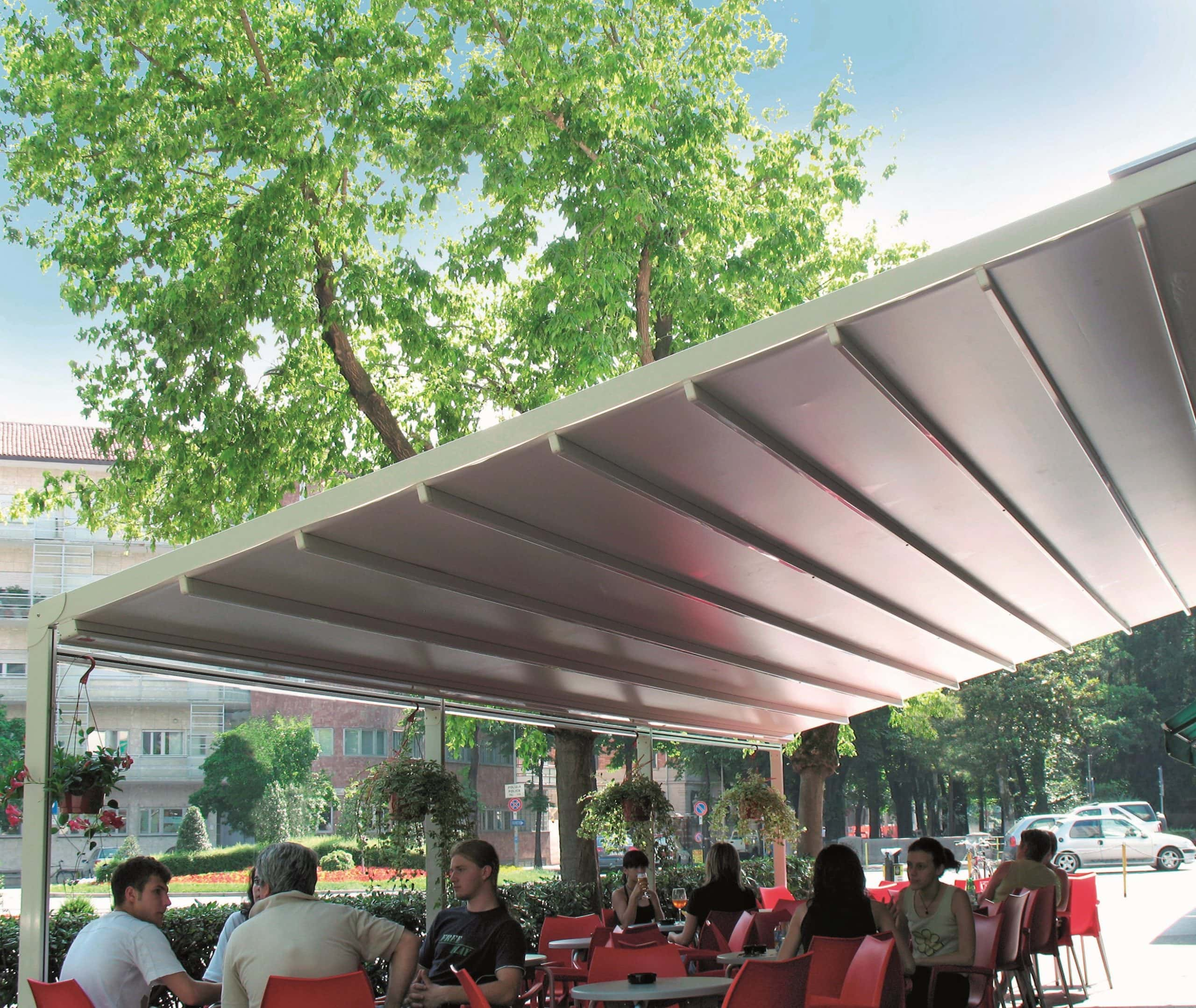 Lourve roof systems - aluminium solar shading shelter over a restaurant outdoor eating area