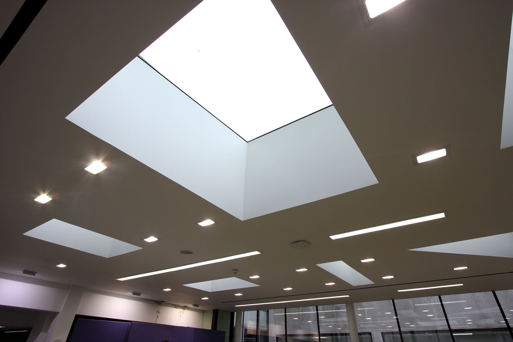 Commercial glazing venting rooflights