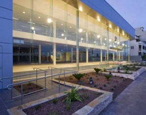 large multiple story glass facade with structural glass