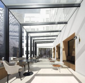 saville row glass box extension as a dedicated wellness space in an office