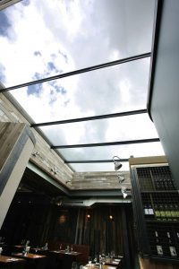 Commercial retractable glass roof