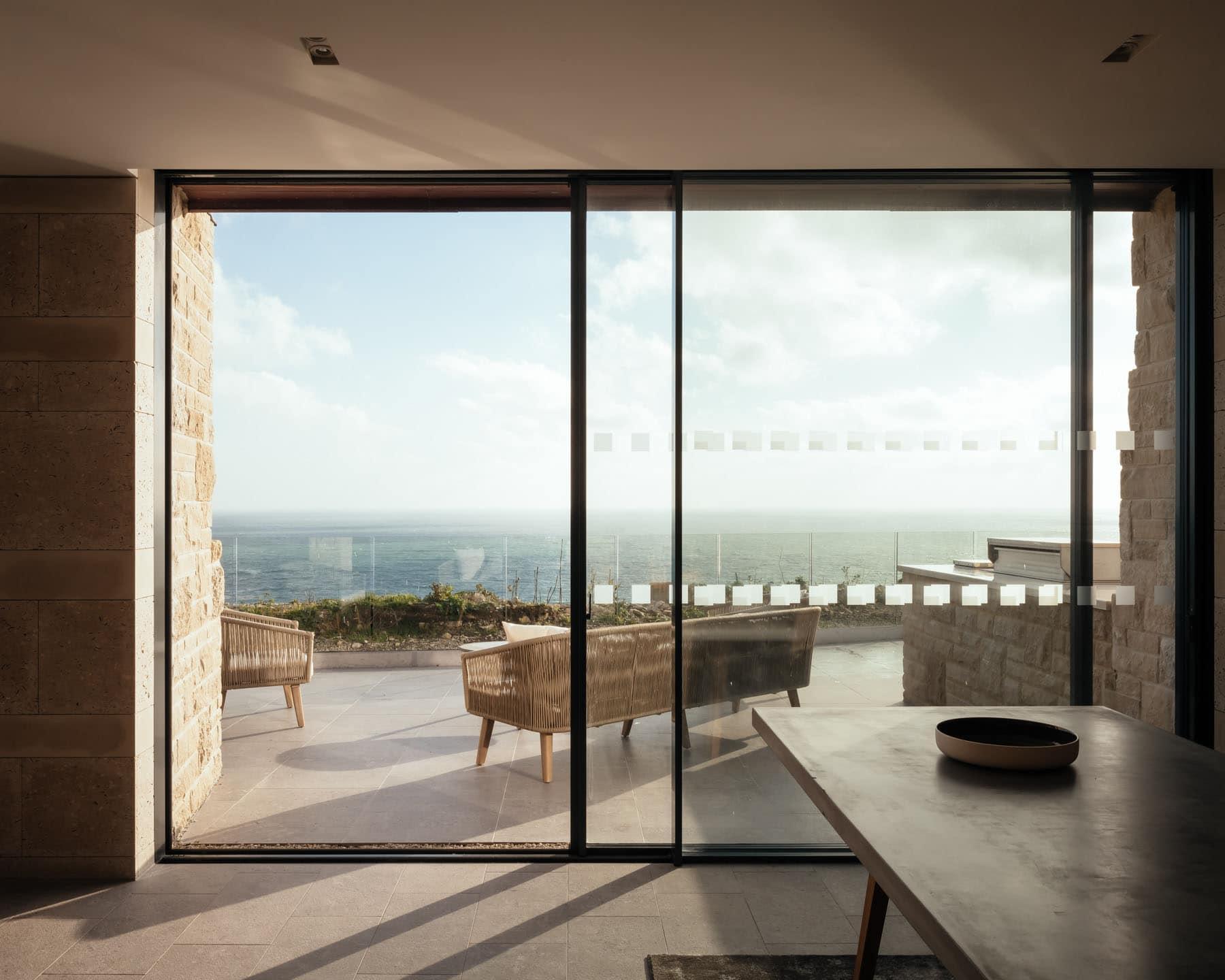 Slim framed sliding door systems link coastal holiday home with balcony