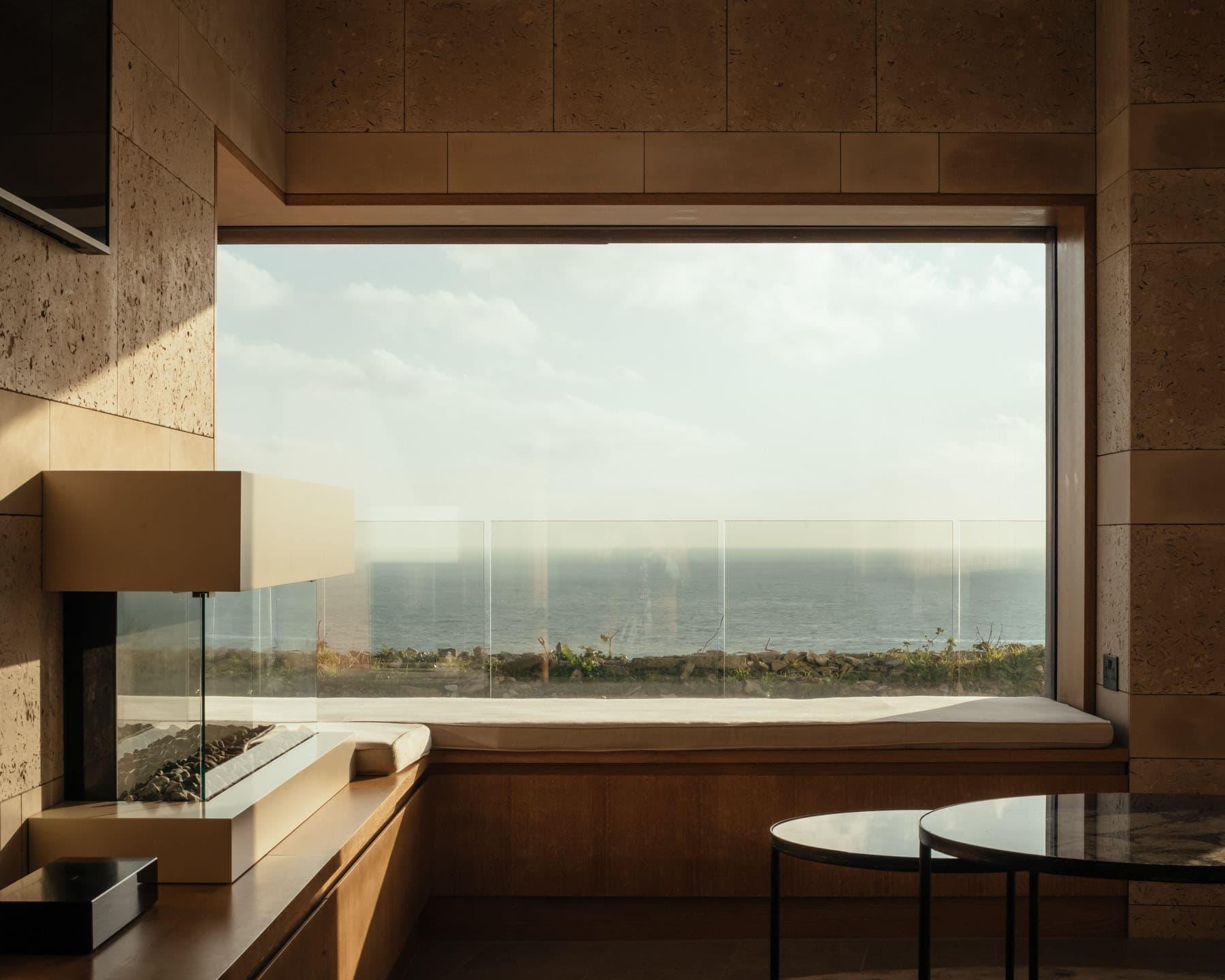 Frameless picture window overlooking coastal views