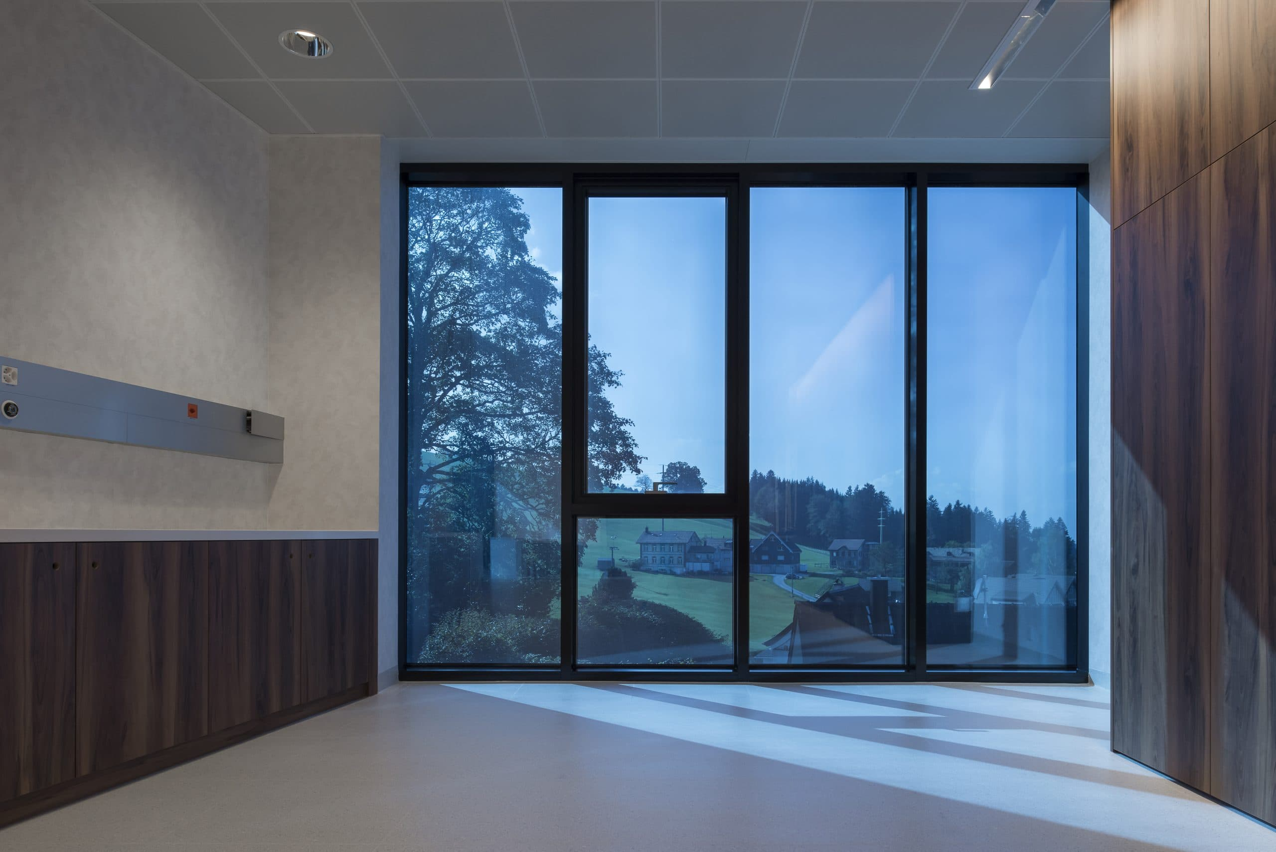 blue tinted electrochromic glass window used for a eye clinic in switzerland
