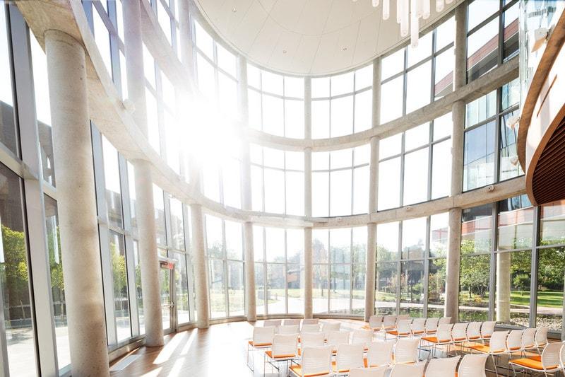 large curved glass elevation to university atrium