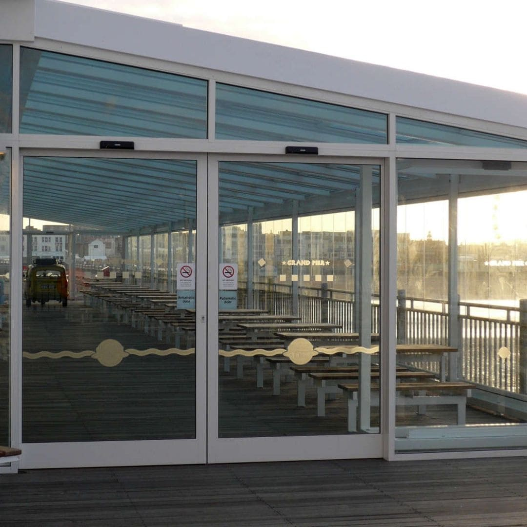 cafe on the pier in bristol with an outdoor dining area and a retractable glass roof to make the area usable all year round