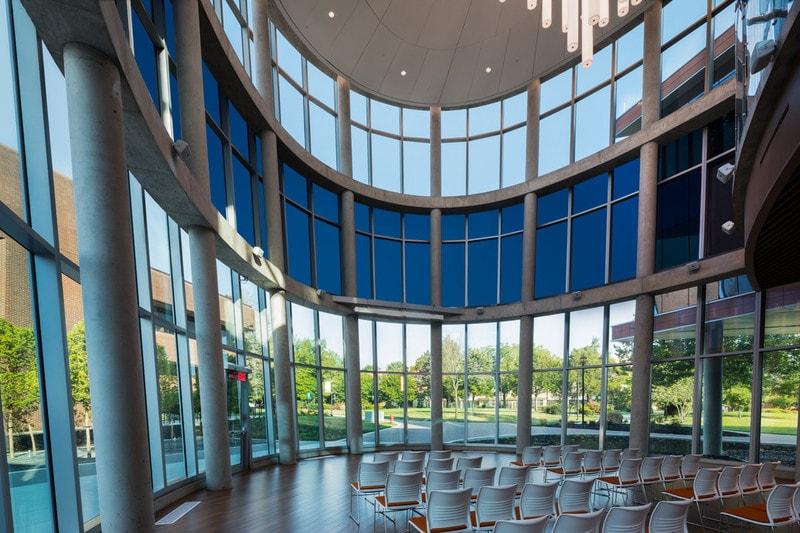 split layers of electrochromic glass to university atrium