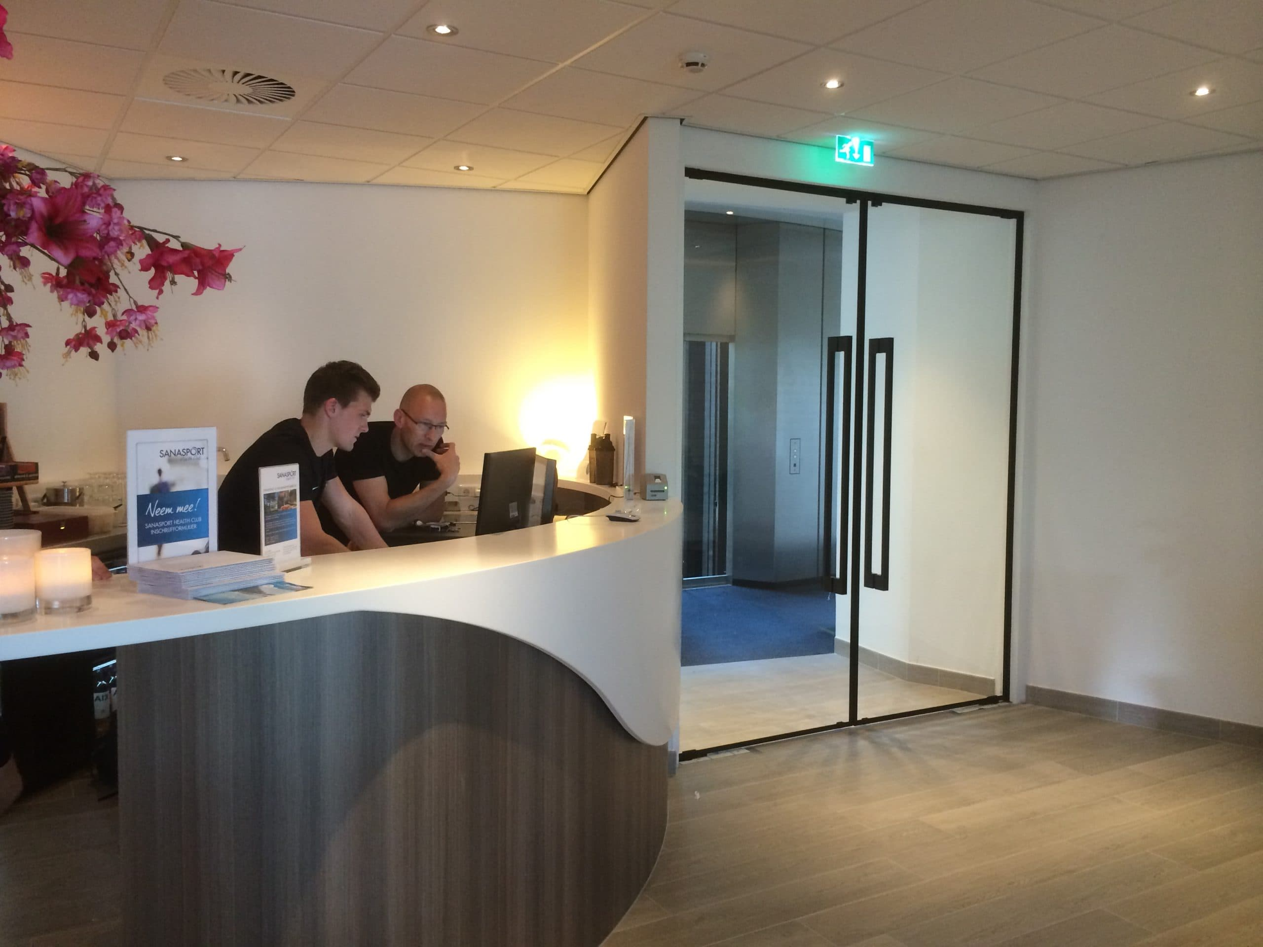 Modern hotel reception with frameless fire rated doors