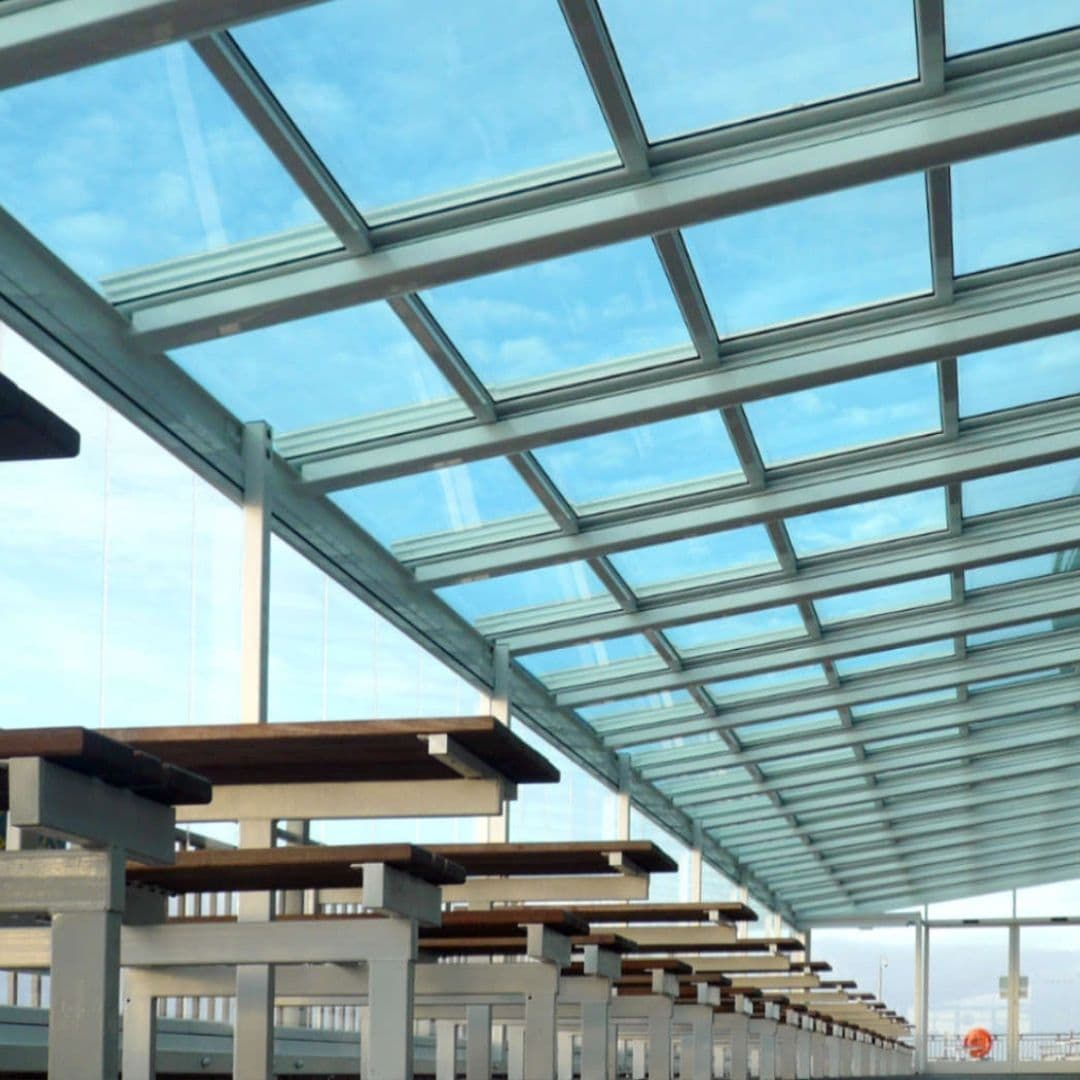 large retractable glass roof used for a seafront outdoor seating area
