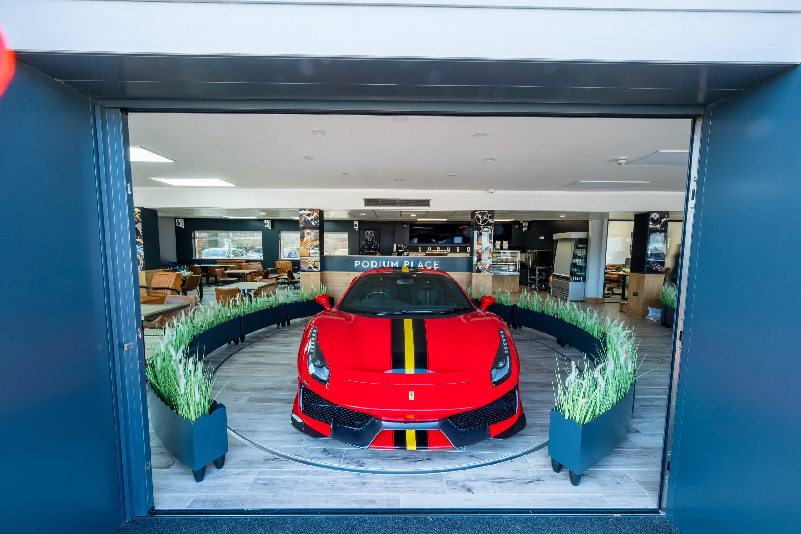 luxury car garage showroom with structural glazing and large glass elevations to showcase the luxury cars