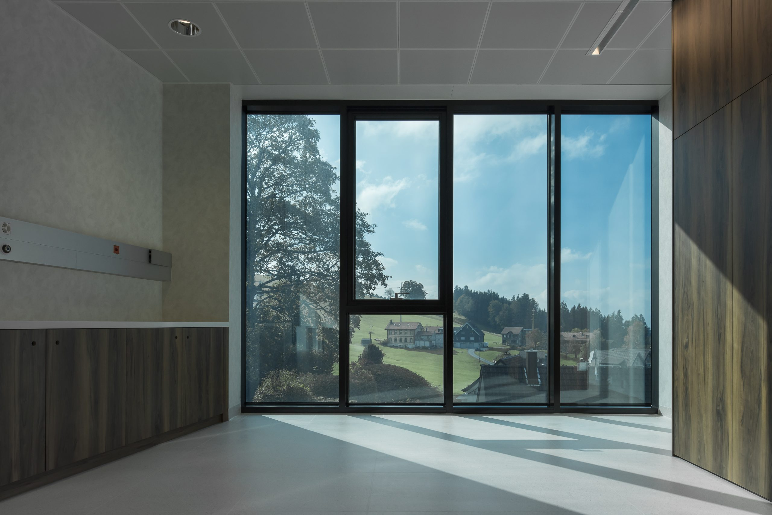 meadium tinted electrochromic glass window used in a healthcare clinic in switzerland
