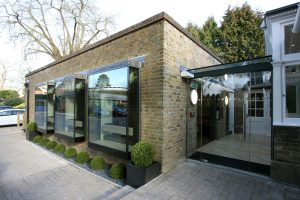 Frameless oriel box windows and structural glazed link to listed manor house renovation