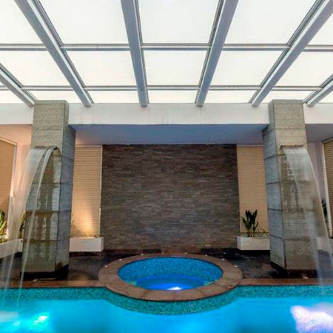 retractable glass roof used over a swimming pool so the indoor pool and be turned into and outdoor pool