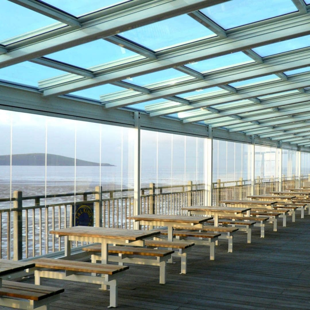 retractable glass roof used over an outdoor dinig area on grand pier in bristol