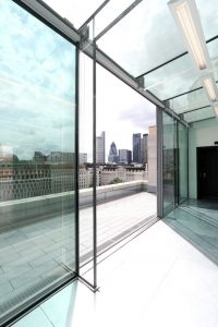 structural glass wall and glass roof with slim sliding doors