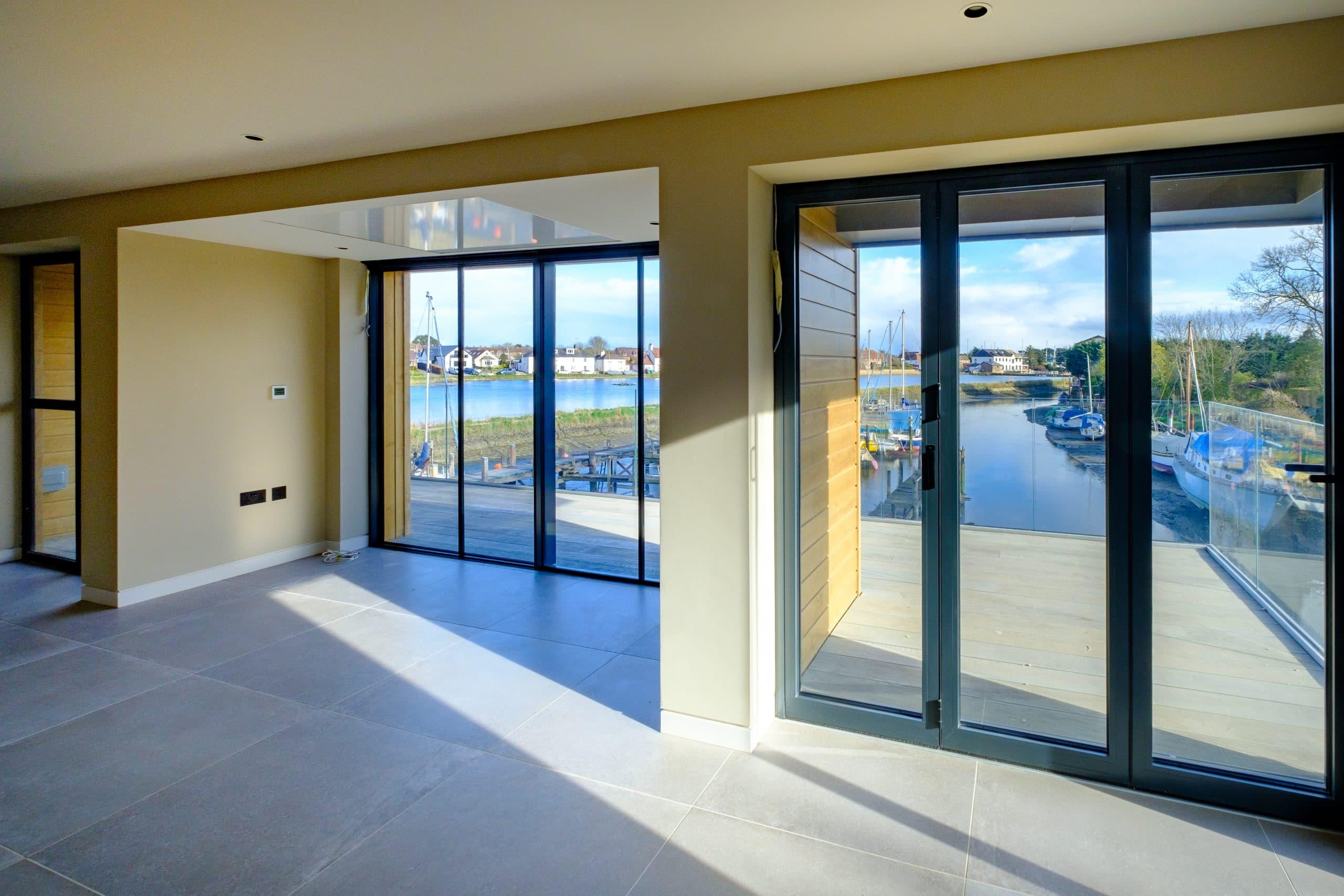 aluminium bifold door and aluminium sliding door in a luxury residential development by the coast