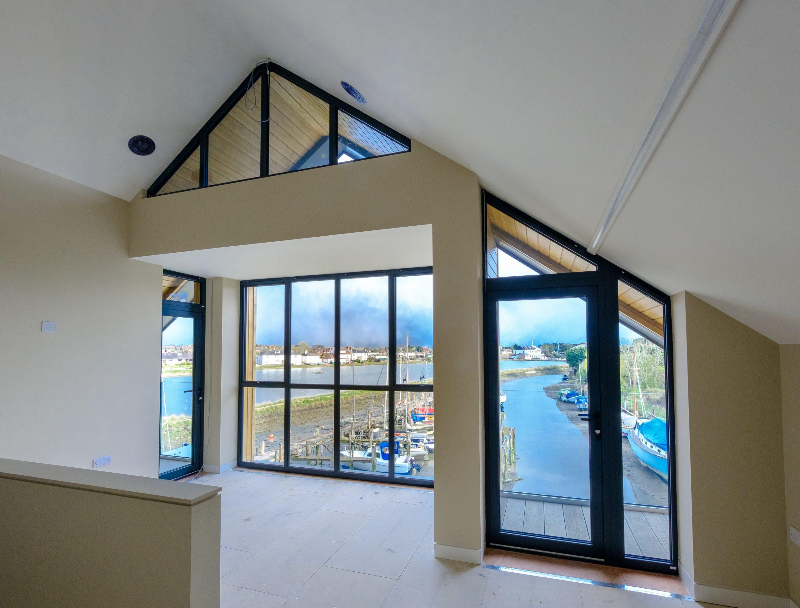 aluminium slim sliding doors and gable end windows with marine grade aluminium framing
