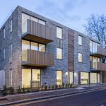 Banner Image of the crown luxury residential development that used a glass box extension on the roof